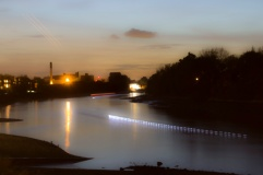 Long exposure of rowers on the Thames at Night, using an ND filter, also,