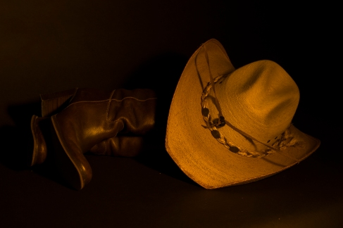 Still life photography of cowboy hat and boots