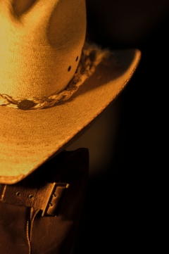 Still life photograph of cowboy hat and boots