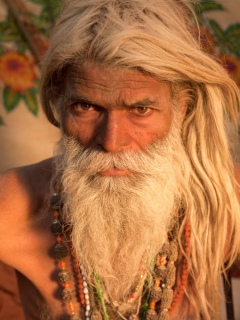 Colour photographic portrait of a bearded yogi by Michael O'Neill