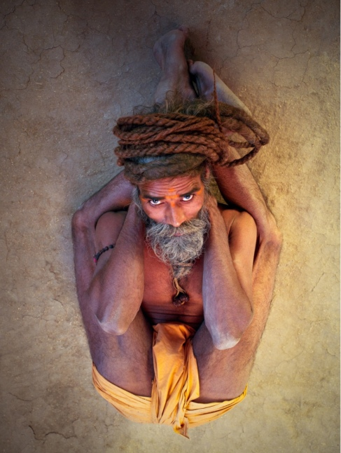 Colour photograph taken from above of yogi in sleeping pose